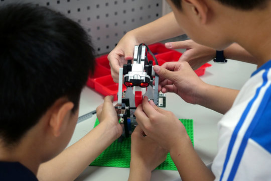 Elementary school students build a motion sensor controlled disinfectant dispenser from Lego parts during a workshop, following a novel coronavirus outbreak, in the southern Taiwanese city of Kaohsiung