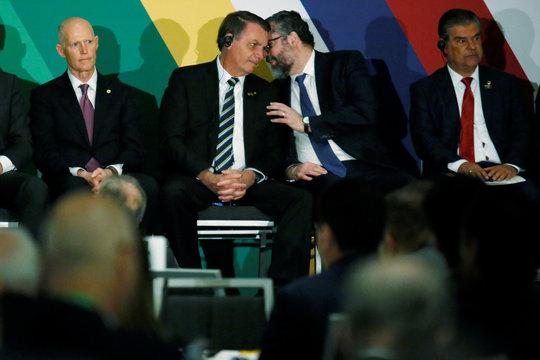 Brazilian President Jair Bolsonaro speaks with Brazilian Foreign Minister Ernesto Araujo during the Brazil-USA Business Relations Seminar, in Miami