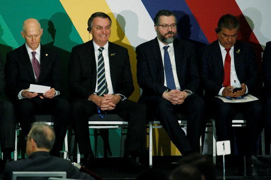 Brazilian President Jair Bolsonaro smiles during the Brazil-USA Business Relations Seminar, in Miami