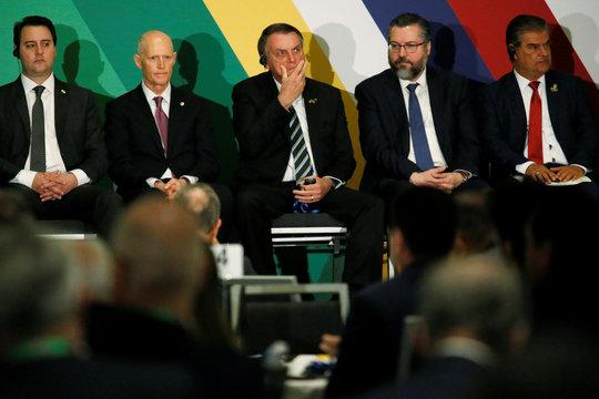 Brazilian President Jair Bolsonaro gestures during the Brazil-USA Business Relations Seminar, in Miami