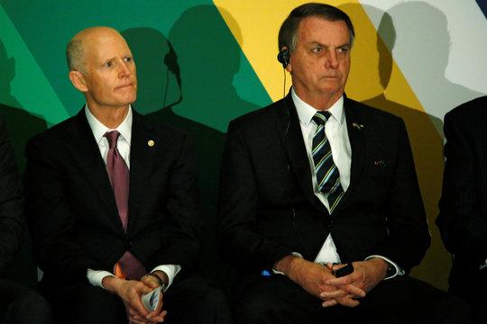 Brazilian President Jair Bolsonaro and U.S. Senator Rick Scott (R-FL) attend the Brazil-USA Business Relations Seminar, in Miami