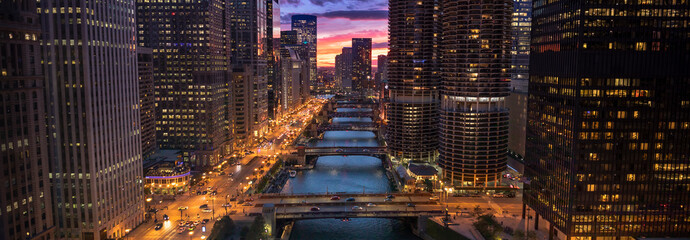Downtown city buildings and skyline over the Chicago River Illinois USA Fotomurales