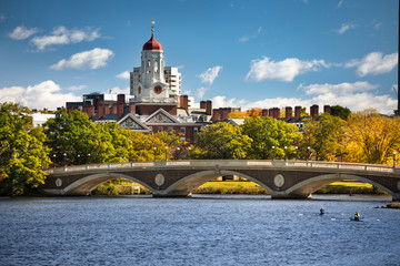 The dome of Harvard University's Dunster House and John W. Weeks Bridge over Charles River in Cambridge Massachusetts USA