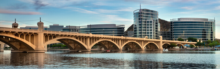 Zelfklevend Fotobehang Arizona Phoenix, Arizona - April 8, 2019: Cityscape panoramic shore view of downtown Tempe Arizona USA over the Salt River and Mill Avenue Bridge