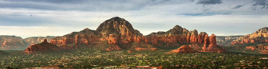 Capitol Butte and Coffee Pot Rock formation panoramic as seen from Airport Mesa over the town of Sedona Arizona USA