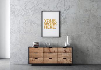 Poster in Black Vertical Frame on Concrete Wall Over Dresser Mockup