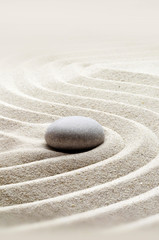 Photo sur Plexiglas Zen pierres a sable zen garden meditation stone background with stones and lines in sand for relaxation.