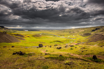 Canvas Prints Honey Wonderful icelandic nature landscape. View from the top. High mountains, snow, tar road, mountain river and green grassland.
