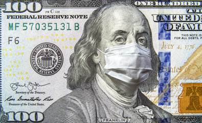 COVID-19 coronavirus in USA, 100 dollar money bill with face mask. Coronavirus affects global stock...