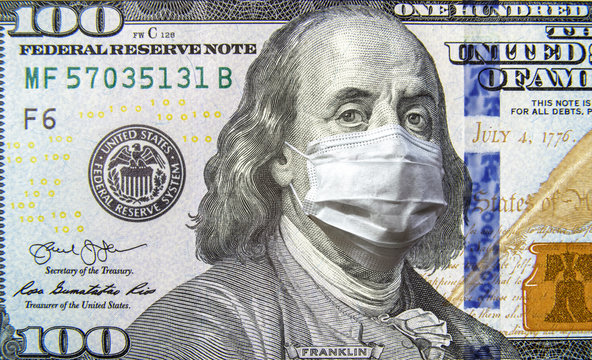 COVID-19 coronavirus, economy and financial crisis, money bill with mask. Coronavirus affects global stock market.