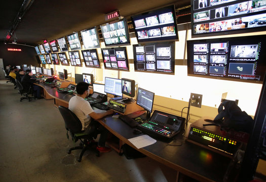 """People work at a control room of Multimedios Television during """"A Day Without Women"""" protest, as part of protests against gender violence, in Monterrey"""