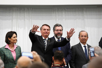 Brazilian President Jair Bolsonaro greets supporters after speaking during a meeting with the Brazilian community at The Miami Dade College Auditorium, in Miami