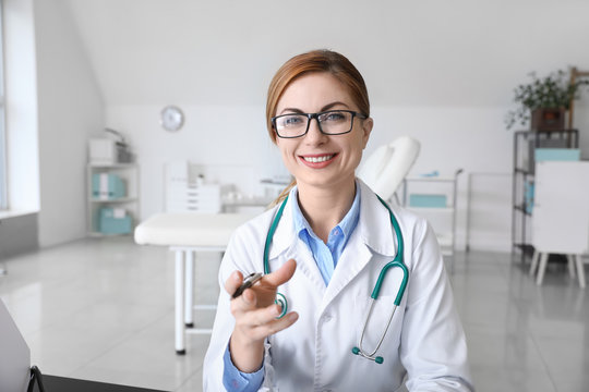 Female doctor using video chat in clinic