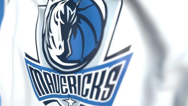 Flying flag with Dallas Mavericks team logo, close-up. Editorial 3D rendering