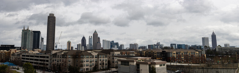Wall Mural - Downtown Atlanta Skyline showing several prominent buildings, apartments and hotels under a blue sky.