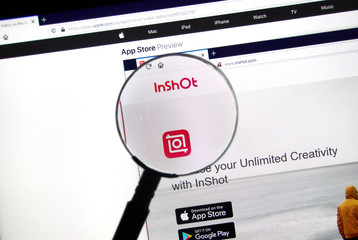 Inshot official homepage and logo under magnifying glass