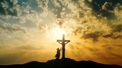 silhouette of jesus christ on the cross