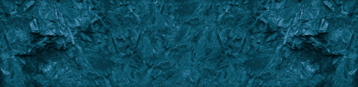 Blue green abstract background. Toned monochrome texture of the mountain. Petrol stone background. Banner with colored stone texture. Marble effect.