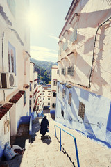 Street in medina of blue town Chefchaouen, Morocco.