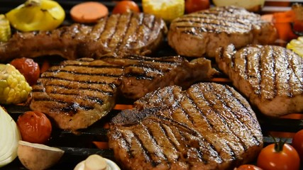 Fototapete - Grilled meat /steak with vegetable on the flaming grill .