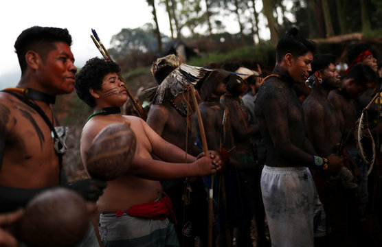 Guarani Mbya indigenous people paint their bodies black as they stay in an occupied area preparing for eviction, after a protest against tree cutting and the construction of an apartment complex near Jaragua indigenous land in Sao Paulo