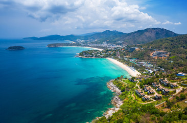 Wall Mural - Aerial view of the coastline of Phuket island with tropical sandy beaches and mountains at sunny day, Thailand