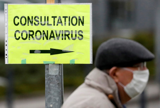 COVID-19 consultation sign at an entrance of the hospital in Vannes