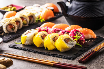 Foto op Plexiglas Sushi bar apanese sushi food. Maki ands rolls with tuna, salmon, shrimp, crab and avocado. Top view of assorted sushi. Rainbow sushi roll, uramaki, hosomaki and nigiri