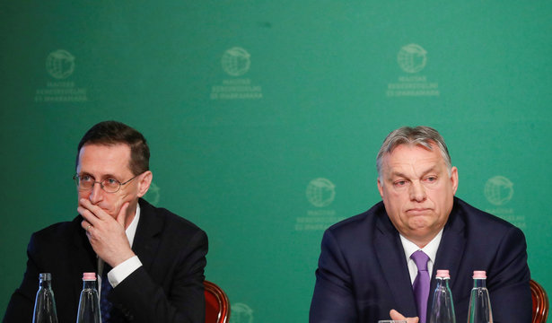 Hungarian Prime Minister Viktor Orban and Hungarian Finance Minister Mihaly Varga attend a business conference in Budapest