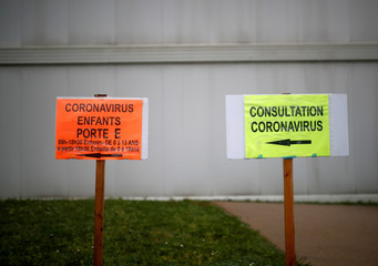 Coronavirus consultation sign at an entrance of the hospital in Vannes