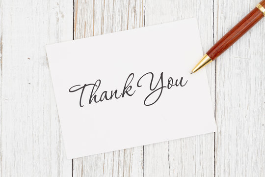 Thank you greeting card with pen on weathered whitewash wood