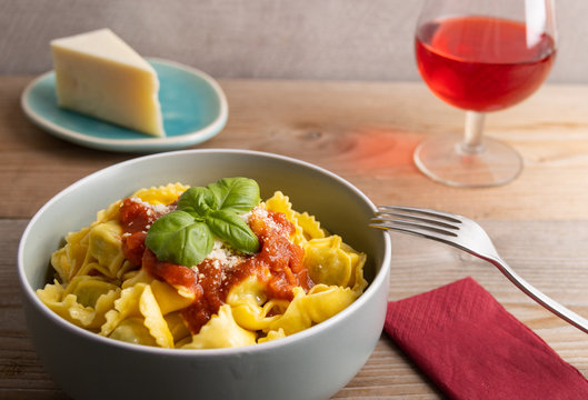 Fresh made delicious italian tortellini with arrabbiata sauce and cheese