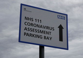 Signage directing patients towards a Coronavirus assessment bay is seen outside Whiston Hospital in Liverpool