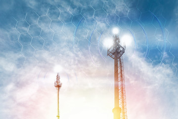 Telecommunications antenna against the clear blue sky with the image of the grid. Copy space. The concept of communication, technology and telecommunications