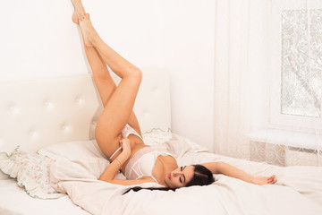 Obraz Hot babe. Sexual games. Womens underwear. depilation and skincare concept. female beauty salon. Beauty and fashion. sexy legs. body of girl relax. Sensual photo of woman in bedroom - fototapety do salonu
