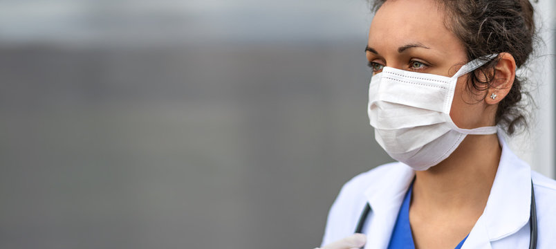 Biology and science. Doctor wearing protection face mask. Virus or bacteria cells. Global alert. Epidemic flu. Coronavirus. Medical staff preventive gear.