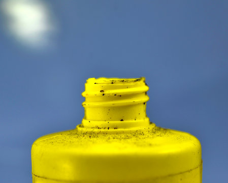 dirty yellow chemical bottle, pollution concept