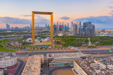Spoed Fotobehang Dubai Aerial view of Dubai Frame, Downtown skyline, United Arab Emirates or UAE. Financial district and business area in smart urban city. Skyscraper and high-rise buildings at sunset.
