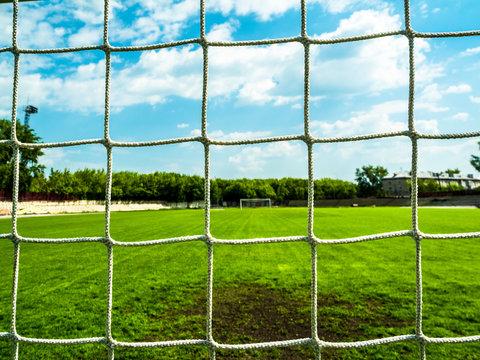 Football net on green field.