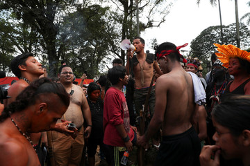 Guarani Mbya indigenous people leave an area after an eviction order they occupied as a protest against tree cutting and the construction of an apartment complex near Jaragua indigenous land in Sao Paulo