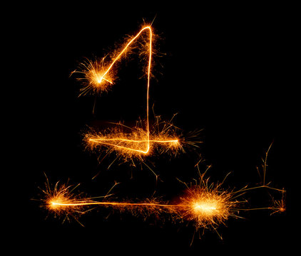 number one written with a sparkler on a black background