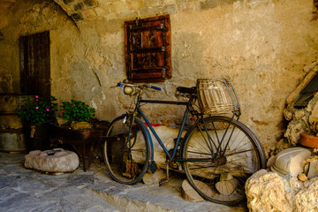 Printed kitchen splashbacks Bicycle Street photography. Old black bicycle with wicker basket.