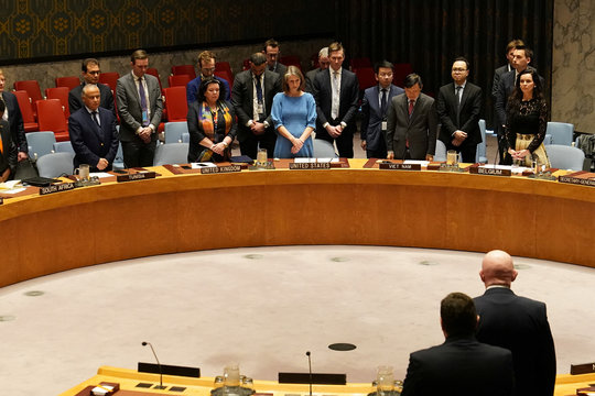 Members of the United Nations Security Council observe a moment of silence at the beginning of a meeting about Afghanistan at United Nations Headquarters in the Manhattan borough of New York City