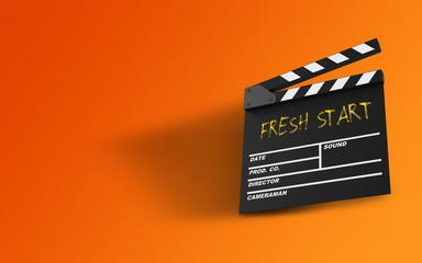 Fresh Start Message Written On A Clapperboard Against Orange