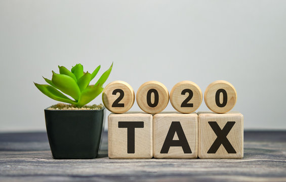 Text - tax 2020 on wooden cubes, on wooden background