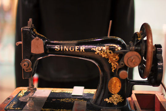 """Kiev, Ukraine - January 22, 2019. Antique Sewing Machine """"Singer"""". Singer is a famous manufacturer of sewing machines."""