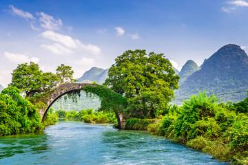 Foto auf Leinwand Guilin Yangshuo, China at the Dragon Bridge spanning the Li River.