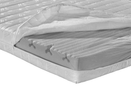 Mattress composition.Orthopedic mattress in section on white background.