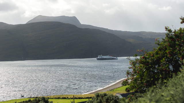arriving ferry in bay at summer, ullapool scotland