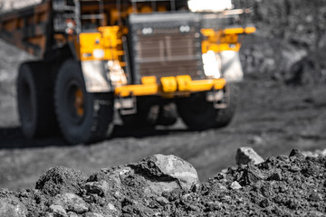 Big yellow mining truck for coal move. Open pit mine industry